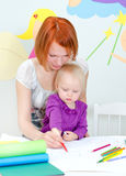 Mother and child drawing Royalty Free Stock Photography