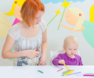 Mother and child drawing. Stock Image