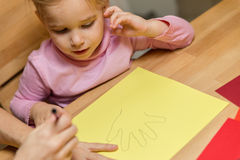 Mother and Child are drawing theirs hands Royalty Free Stock Photography