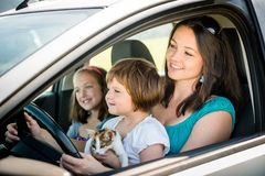 Mother and child driving car Royalty Free Stock Images