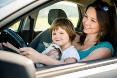 Mother and child driving car Royalty Free Stock Image
