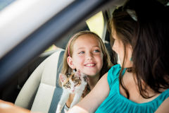 Mother and child driving car Stock Images