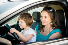 Mother and child driving car Royalty Free Stock Photography