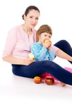 Mother with a child eat apples Royalty Free Stock Images
