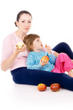 Mother with a child eat apples Stock Photo