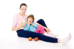 Mother with a child eat apples Stock Photos