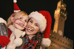 Mother and child eating Christmas candy cane in Florence, Italy Stock Images