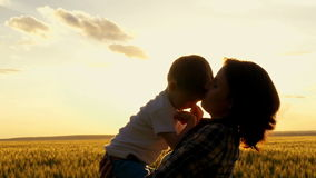 Mother and child embrace and laugh at the sunset stock video footage