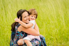 Mother and child embracing Stock Images