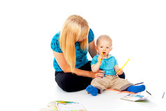Mother and child are engaged in drawing Royalty Free Stock Image