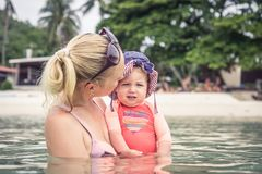 Mother and child enjoy swimming in sea during travel beach holidays. Mother and baby enjoy swimming in sea during travel beach holidays Royalty Free Stock Photo