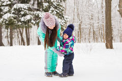 Mother and child enjoying beautiful winter day outdoors.  Stock Images
