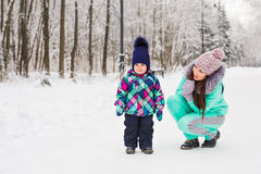 Mother and child enjoying beautiful winter day outdoors.  Royalty Free Stock Photos