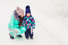 Mother and child enjoying beautiful winter day outdoors.  Stock Photo