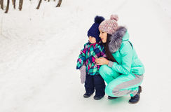 Mother and child enjoying beautiful winter day outdoors.  Stock Image