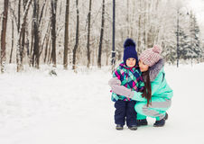 Mother and child enjoying beautiful winter day outdoors.  Stock Photography