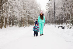 Mother and child enjoying beautiful winter day outdoors.  Royalty Free Stock Photo