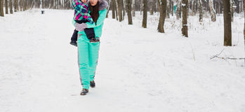 Mother and child enjoying beautiful winter day outdoors.  Stock Photos