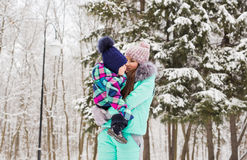 Mother and child enjoying beautiful winter day outdoors.  Royalty Free Stock Image