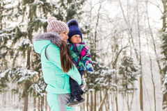 Mother and child enjoying beautiful winter day outdoors.  Royalty Free Stock Photography