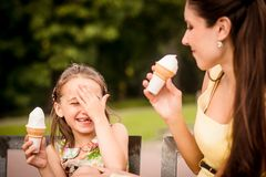 Mother and child enjoying icecream Royalty Free Stock Photography