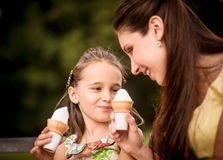 Mother and child enjoying icecream Stock Photos