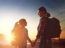 Mother and child enjoying journey. Two travelers at sunset. Mother and child daughter girl are having fun and enjoying journey Stock Image