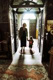Mother and child entering  in a church Royalty Free Stock Images
