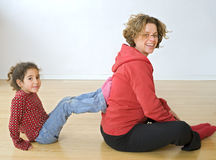 Mother and child exercising Stock Images