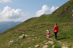 Mother and child family hiking. Family : mother and child hiking in the Alps, Zillertal Austria stock photo