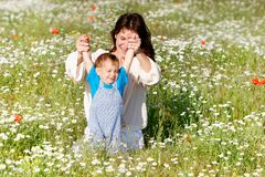 Mother and child in field Royalty Free Stock Images