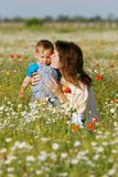 Mother and child in field Stock Image