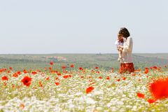 Mother and child in field Royalty Free Stock Photography