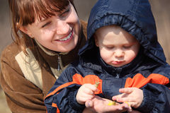 Mother with child and first flower in spring Stock Image