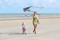 Mother and child flying kite on the beach Royalty Free Stock Photo