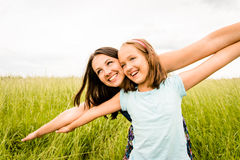 Mother and child flying. Mother and child pretend with hands they are together flying Royalty Free Stock Photo