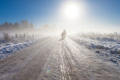 Mother and child on foggy snow farm road Royalty Free Stock Photography