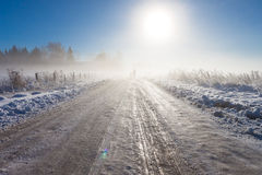 Mother and child on foggy snow road Stock Photo