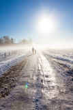 Mother and child on foggy snow road Royalty Free Stock Photo