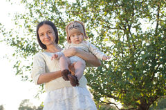 Mother and child in garden Royalty Free Stock Photo