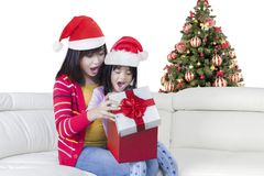 Mother and child with gift box Stock Image