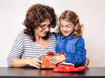 Mother and child girl Christmas present Stock Image