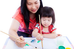 Mother with child girl draw and paint together. Isolated on whit Royalty Free Stock Image