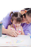Mother with child girl draw and paint together Stock Images