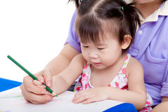 Mother with child girl draw and paint together. Portrait of women and little asian girl drawing and painting together, mother teach her daughter to draw with Stock Images