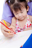 Mother with child girl draw and paint together Stock Photos
