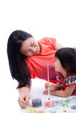 Mother with child girl draw and paint together, on white backgro Royalty Free Stock Photos