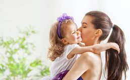 Mother and child girl. Happy cheerful family. Mother and child girl hugging Stock Photography
