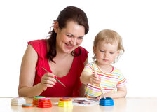 Mother and child girl painting together Stock Photography