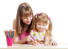 Mother and child girl pencil together Stock Photo